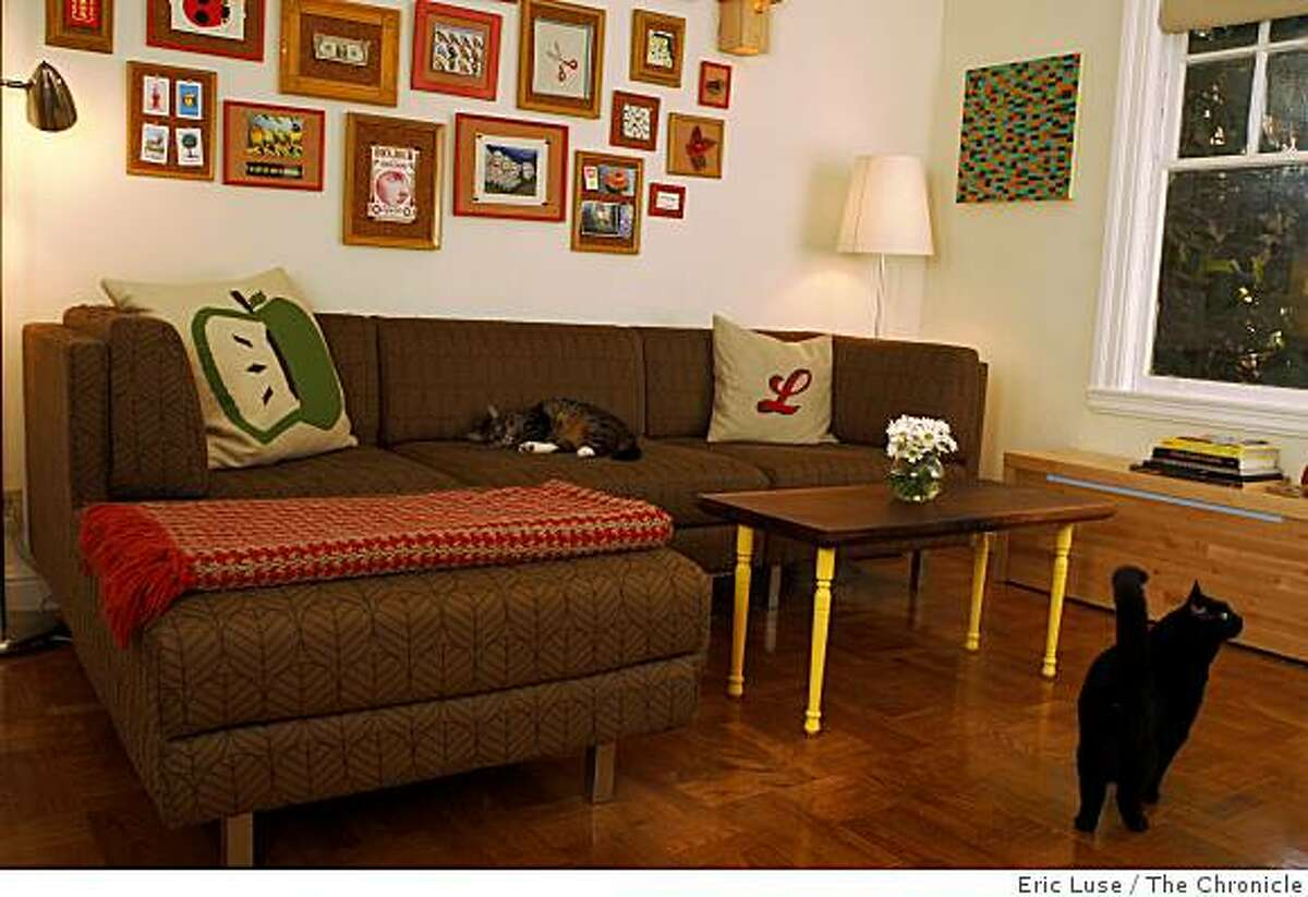 Living room of Lauren Smith and Derek Fagerstrom?•s Mission District apartment which is above their store Curiosity Shoppe in San Francisco photographed on Wednesday, June 2, 2009.