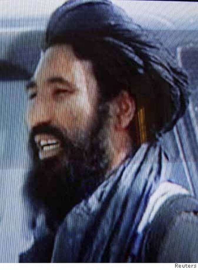 A photograph taken from television shows Mullah Mansour Dadullah in an undated video. Pakistani security forces wounded and captured Mansour Dadullah, a top Taliban commander, on Monday in a raid near the border with Afghanistan, intelligence officials said. Mullah Mansour took over as commander of Taliban forces in the southern Afghan province of Helmand after his brother, Mullah Dadullah, was killed by British forces in May. REUTERS/Handout (AFGHANISTAN). EDITORIAL USE ONLY. NOT FOR SALE FOR MARKETING OR ADVERTISING CAMPAIGNS. 0 Photo: HO