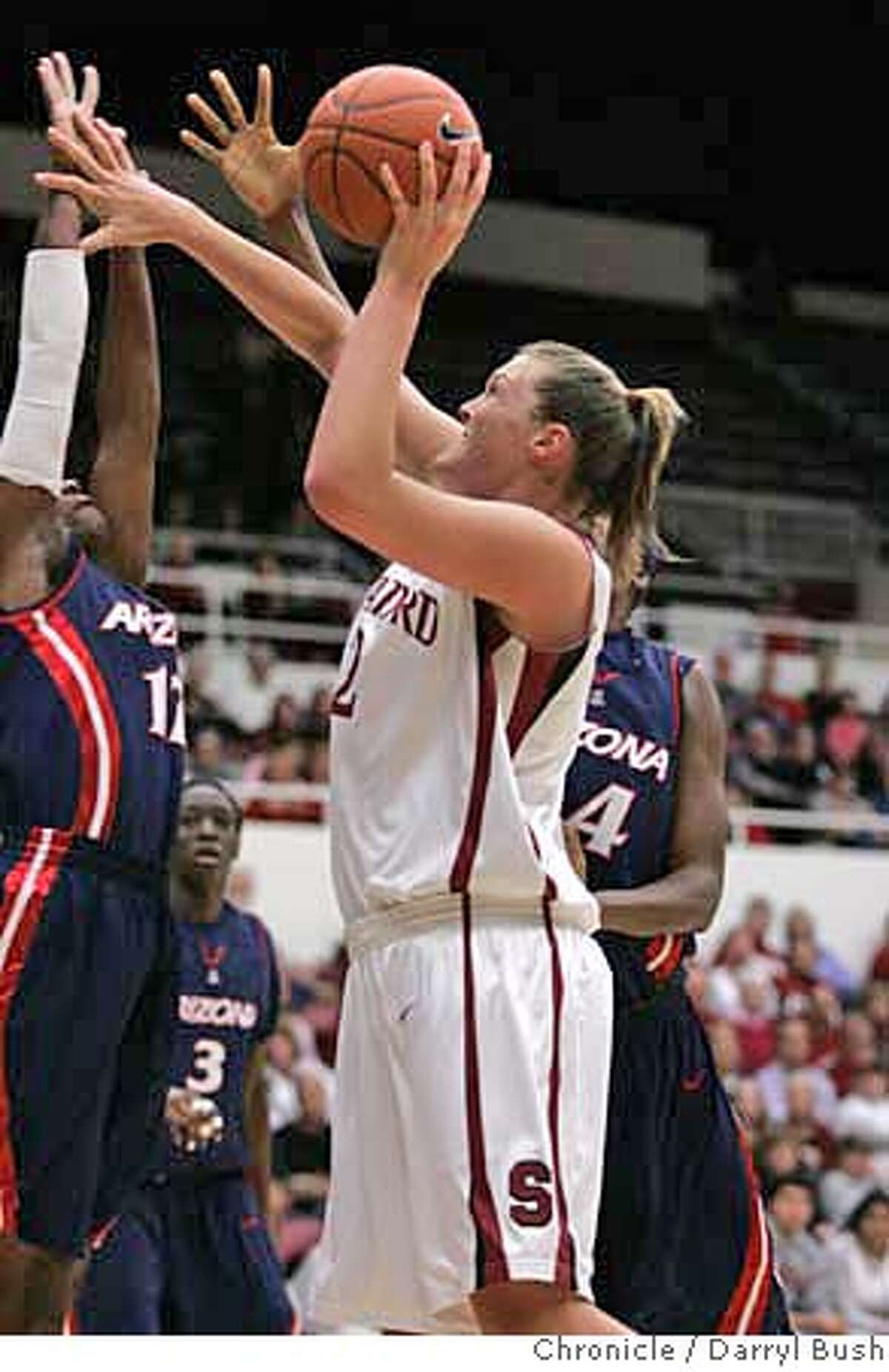 Stanford's Jayne Appel (2) scores over Arizona's Ashley Whisonant, left, and Beatrice Bofia, right, in the first half of their NCAA basketball game in Stanford, Calif., Thursday, Feb. 14, 2008. (AP Photo/Darryl Bush) EFE OUT
