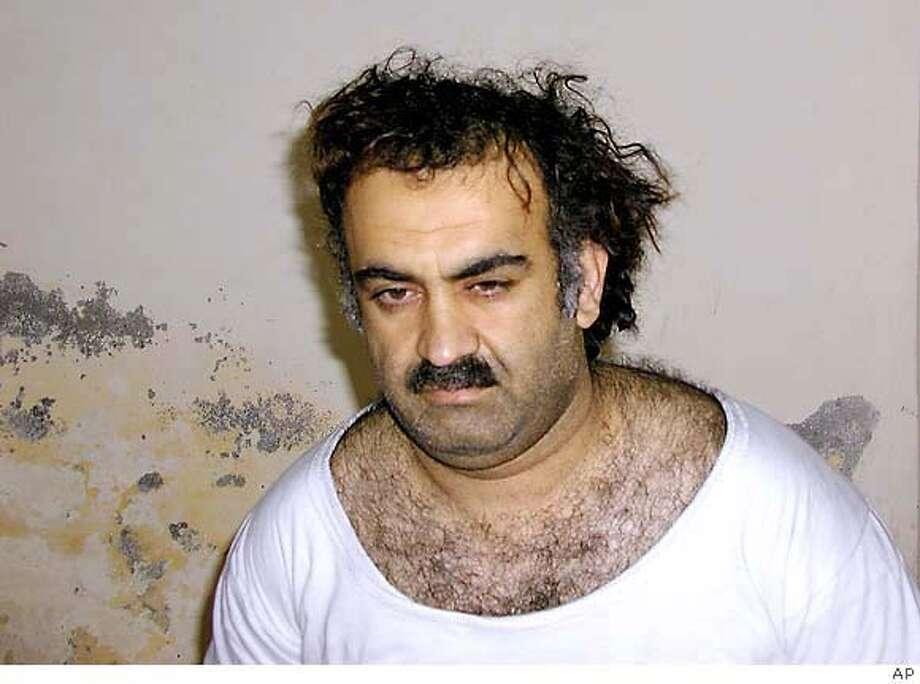 ** FILE ** In a file photo Khalid Sheikh Mohammed, the alleged Sept. 11 mastermind, is seen shortly after his capture during a raid in Pakistan Saturday March 1, 2003, in this photo obtained by the Associated Press. Mohammed confessed to that attack and a string of others during a military hearing at Guantanamo Bay, Cuba, according to a transcript released Wednesday March 14, 2007 by the Pentagon. Mohammed claimed responsibility for planning, financing, and training others for bombings ranging from the 1993 attack at the World Trade Center to the attempt by would-be shoe bomber Richard Reid to blow up a trans-Atlantic flight with explosives hidden in his shoes. (AP Photo)
