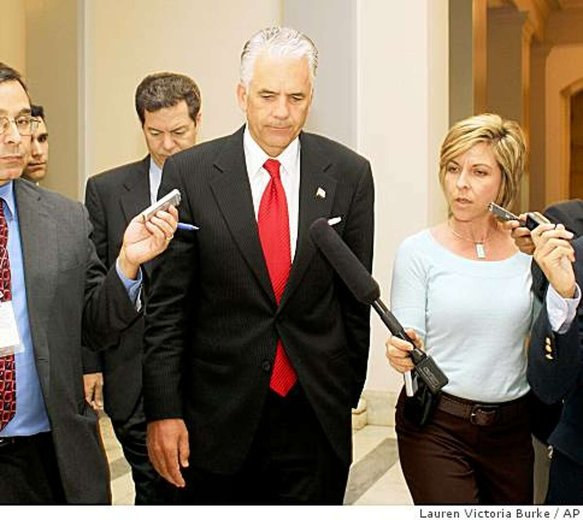 Sen. John Ensign, R-Nev. is seen talking with reporters on his way to a vote on Monday, June 22, 2009 on Capitol Hill in Washington. (AP Photo/Lauren Victoria Burke)