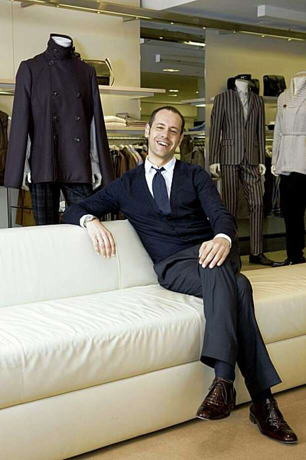 Surrounded by his latest fashion line, Massimiliano Giornetti, the menswear designer for Salvatore Ferragamo Stores sits for a portrait at Ferragamo's in San Francisco, Calif. on Monday, June 1, 2009 before a first ever trunk show. Photo by Kat Wade / Special to the Chronicle Photo: Kat Wade, Special To The Chronicle