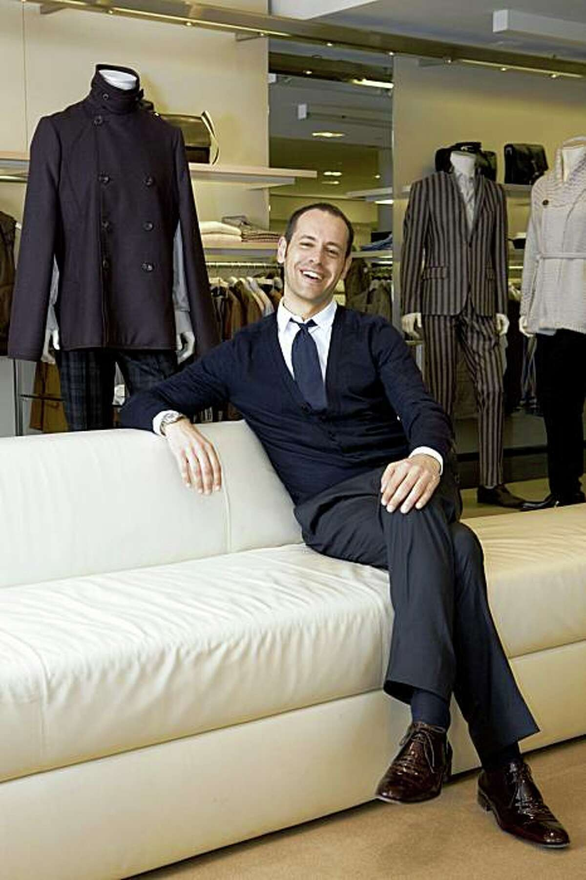 Surrounded by his latest fashion line, Massimiliano Giornetti, the menswear designer for Salvatore Ferragamo Stores sits for a portrait at Ferragamo's in San Francisco, Calif. on Monday, June 1, 2009 before a first ever trunk show. Photo by Kat Wade / Special to the Chronicle