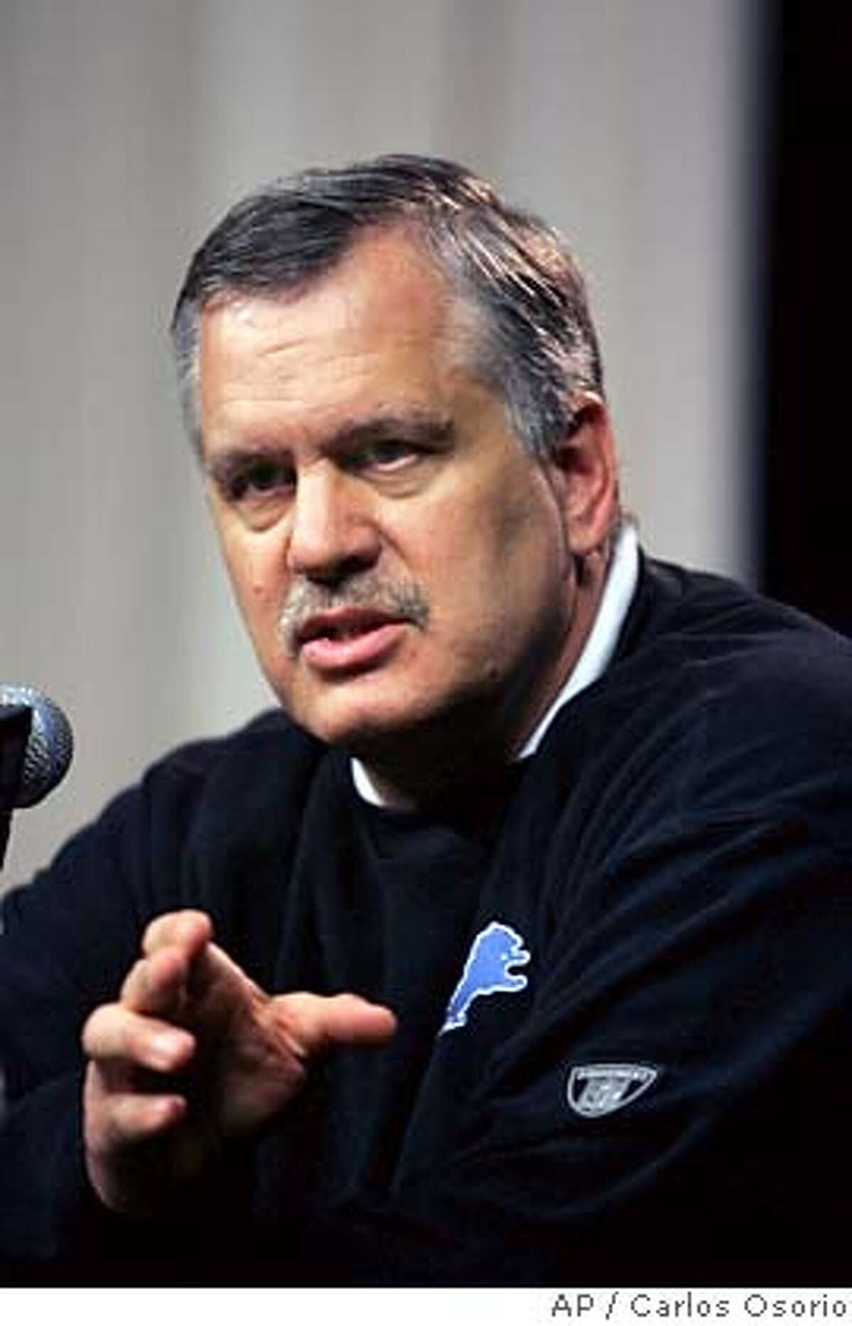 ** FILE **Detroit Lions president Matt Millen answers a question during a news conference at the team's training facility in Allen Park, Mich., in this April 25, 2007 file photo. Millen says he understands fan frustration with him and the organization, but he sees brighter days ahead for the troubled franchise. (AP Photo/Carlos Osorio) APRIL 25, 2007 FILE PHOTO EFE OUT