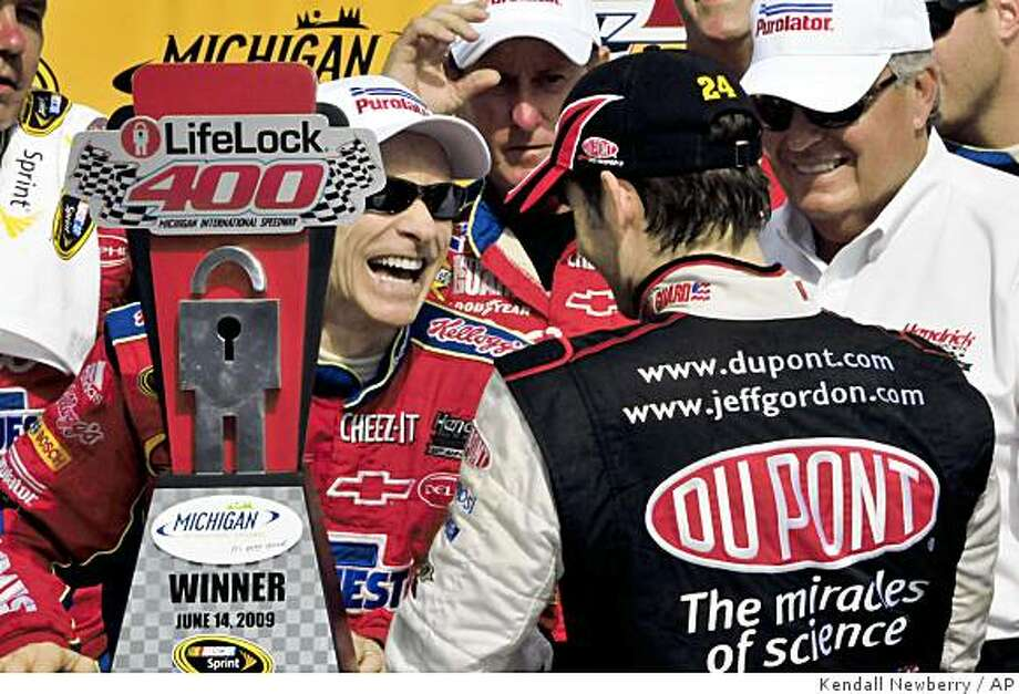 ** AUTO RACING PACKAGE FOR JUNE 17 AND THERAFTER ** FILE - In this June 14, 2009, file photo, driver Mark Martin celebrates his victory with teammate and second-place finisher Jeff Gordon and team owner Rick Hendrick, right, after the NASCAR LifeLock 400 auto race at Michigan International Speedway in Brooklyn, Mich.  Martin wasn't sure he was doing the right thing by returning to NASCAR Sprint Cup racing full time this season. Sprint Cup's graybeard is a lot less ambiguous about his decision now that his third victory of the season has catapulted him to eighth in the standings.  (AP Photo/Kendall Newberry, File) Photo: Kendall Newberry, AP
