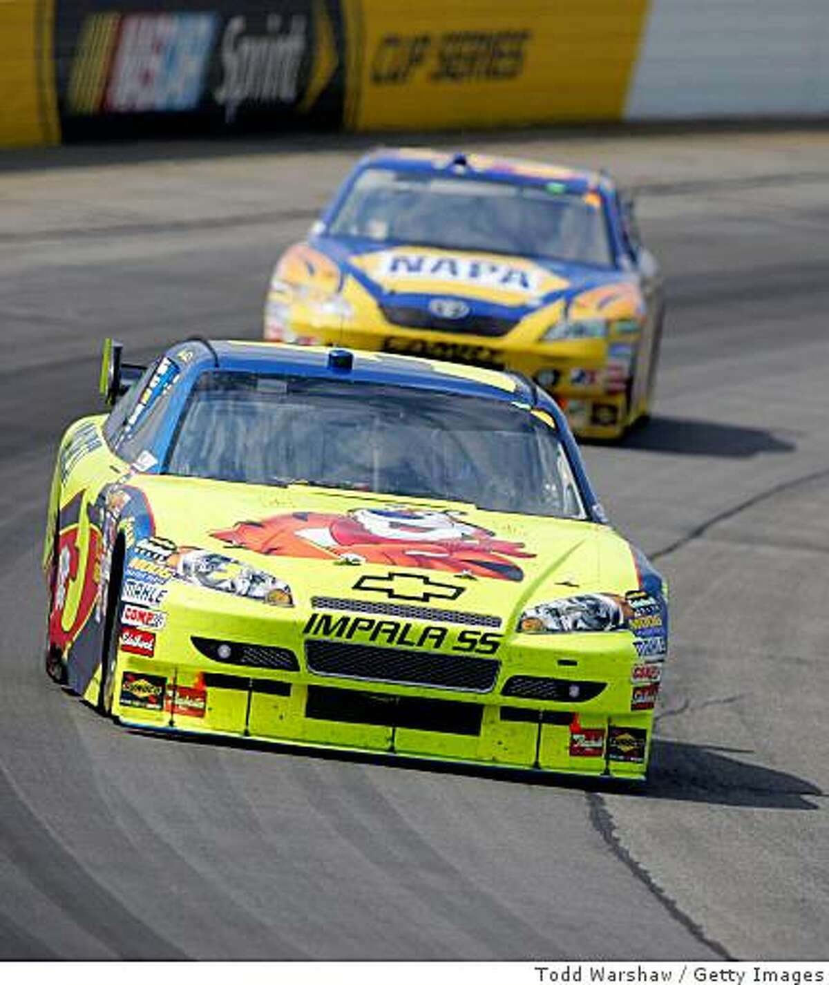 LONG POND, PA - JUNE 07: Mark Martin, driver of the #5 Kellogg's/CARQUEST Chevrolet, leads Michael Waltrip, driver of the #55 NAPA Toyota, during the NASCAR Sprint Cup Series Pocono 500 on June 7, 2009 at Pocono Raceway in Long Pond, Pennsylvania. (Photo by Todd Warshaw/Getty Images)