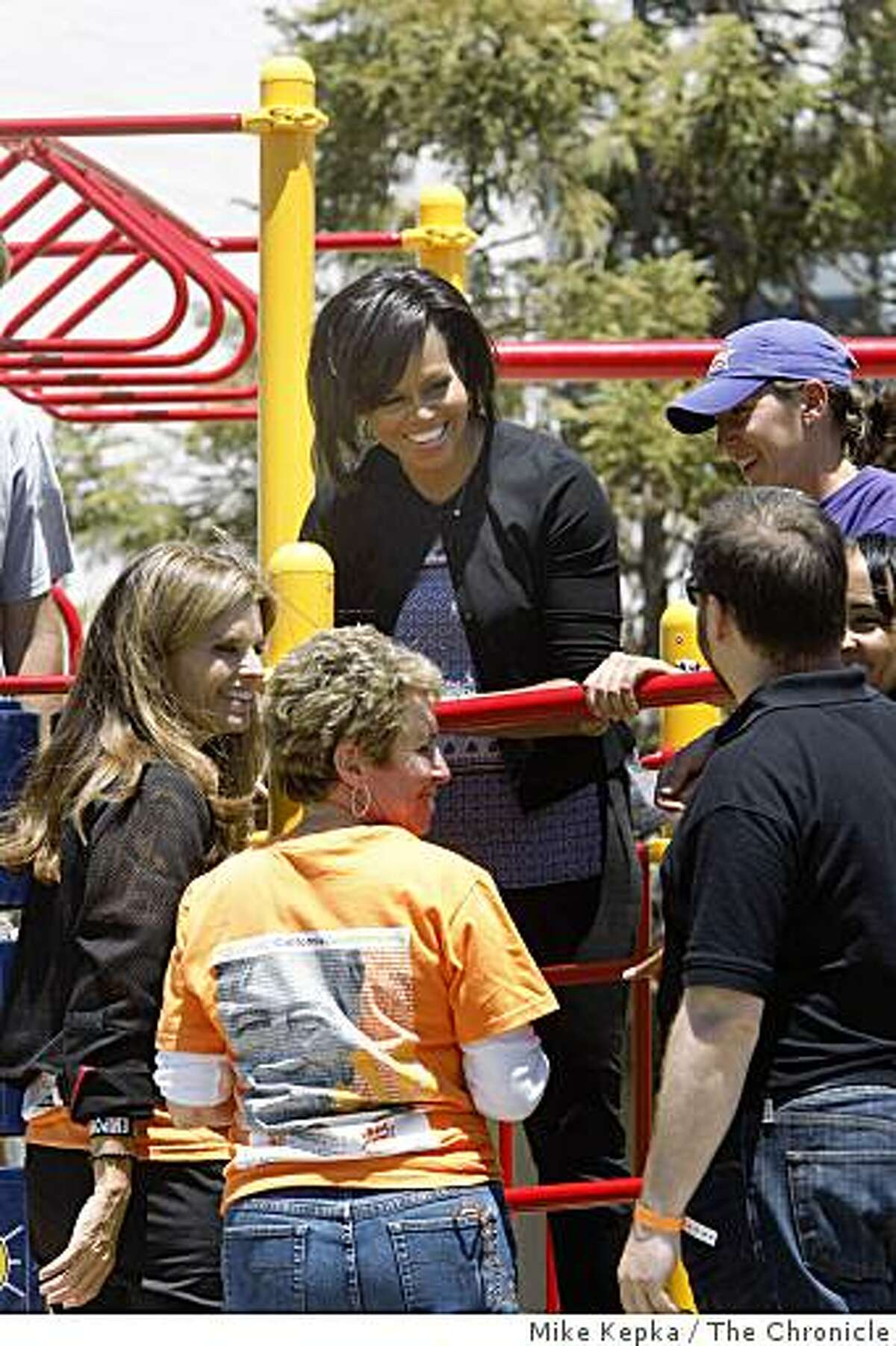 To kick start a national convention of volunteers, first lady Michelle Obama and California's first lady Maria Shriver put the finishing touches on a playground at Bret Harte Elementary School in San Francisco on Monday.