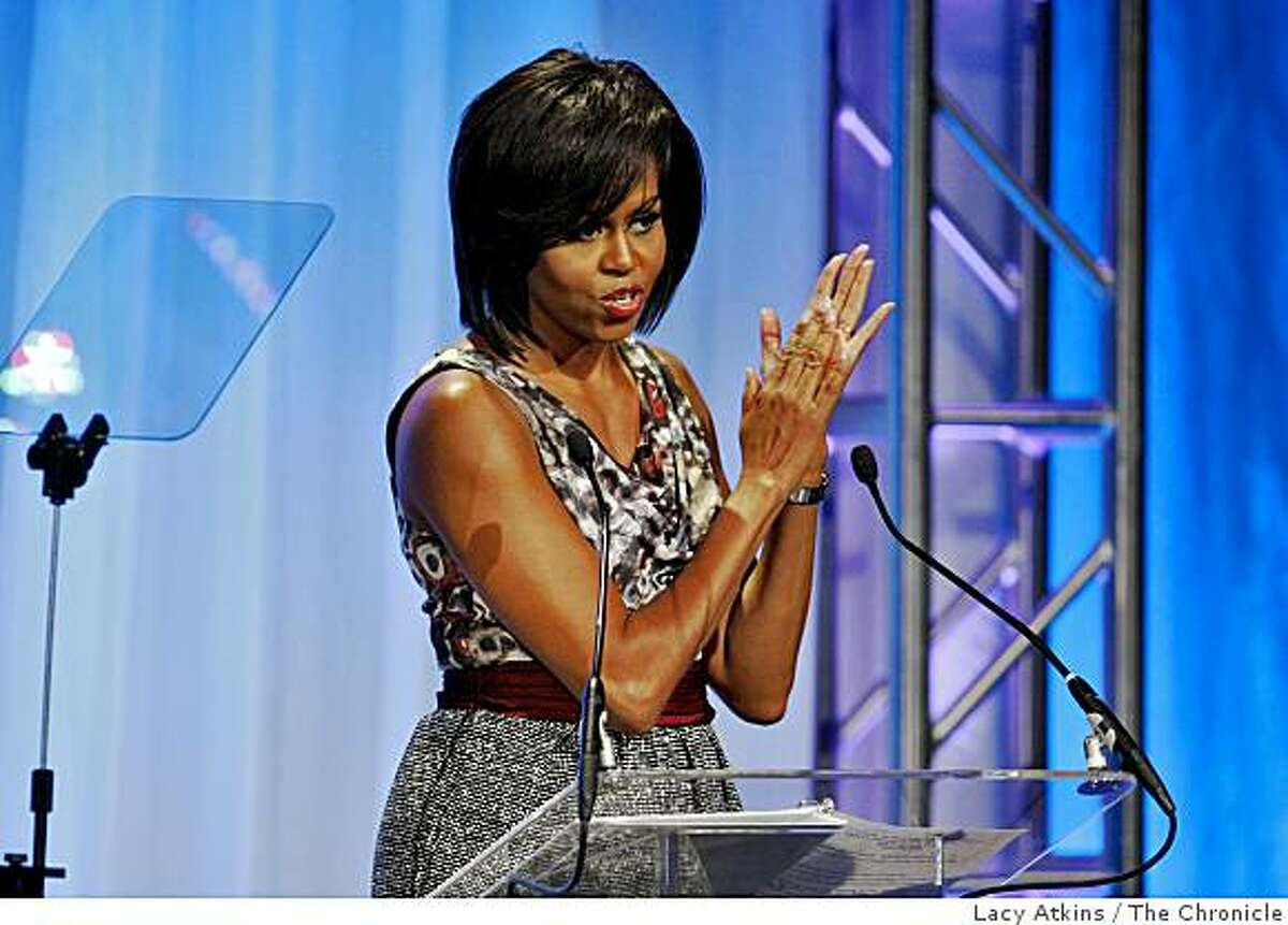 First Lady Michelle Obama applauds the volunteers as she gives the keynote address to thousands of people at the 2009 National Conference of Volunteering and Services, at the Moscone Center, Monday June 22, 2009, in San Francisco, Calif.