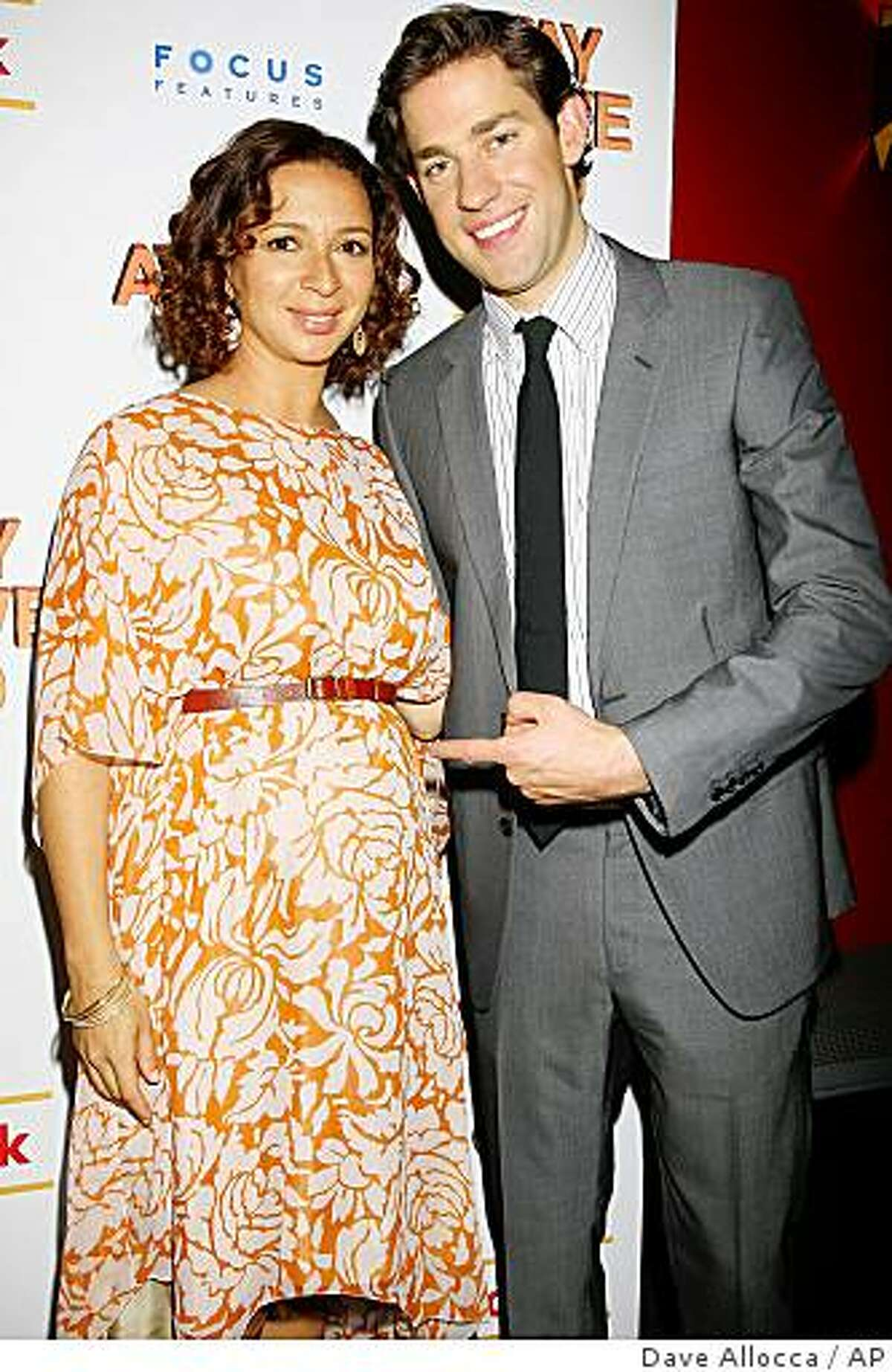 FILE - In this June 1, 2009 file photo provided by StarPix, actors John Krasinski and Maya Rudolph arrive at the the New York premiere of of their film
