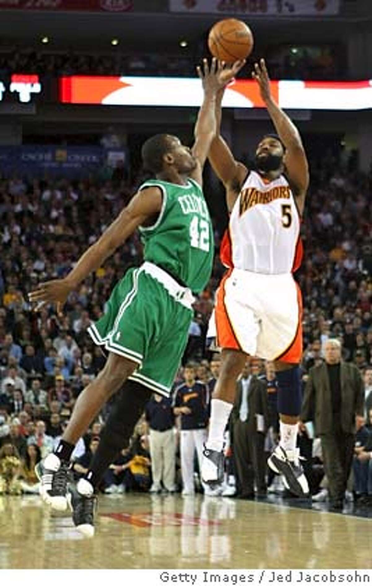 OAKLAND, CA - FEBRUARY 20: Baron Davis #5 of the Golden State Warriors shoots over Tony Allen #42 of the Boston Celtics during an NBA game on February 20, 2008 at Oracle Arena in Oakland, California. NOTE TO USER: User expressly acknowledges and agrees that, by downloading and or using this photograph, User is consenting to the terms and conditions of the Getty Images License Agreement. (Photo by Jed Jacobsohn/Getty Images)