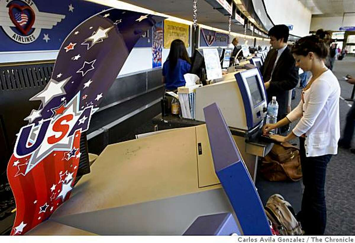 Ann Walkush, of San Francisco, checks in at the Southwest Airlines kiosks in San Francisco International Airport, in San Francisco, Calif., on Wednesday, July 1, 2009. Walkush is flying home to San Diego to be with her family for the Fourth of July holiday.