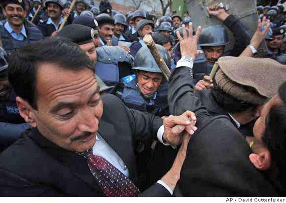 Pakistani riot police charge protesters as they demonstrate against Gen. Pervez Musharraf outside the residence of deposed Chief Justice Iftikhar Mohammed Chaudhry in Islamabad Thursday, Feb. 21, 2008. (AP Photo/David Guttenfelder) Photo: DAVID GUTTENFELDER