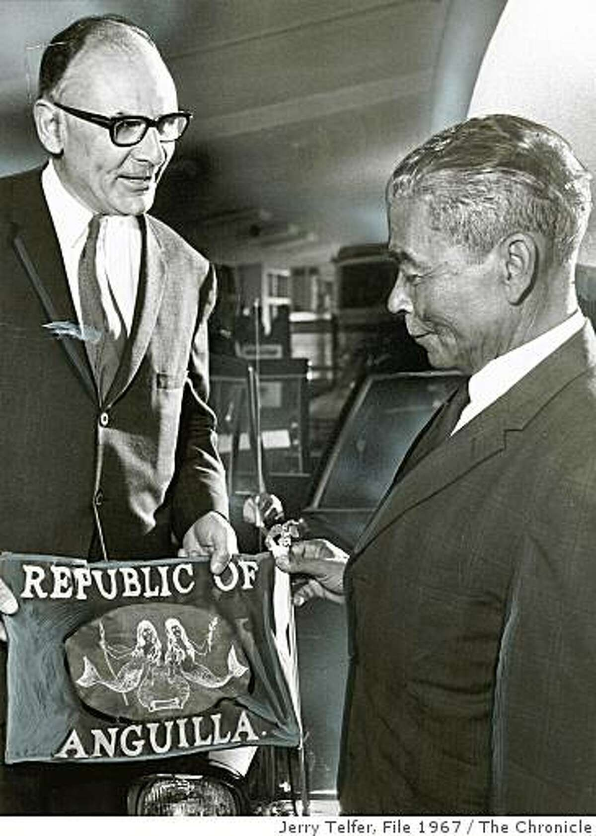 Insight21_Hinckley.jpg July 21, 1967 - Peter Tamaras, Acting Mayor of San Francisco, and Peter Adams, President of the Republic of Anguilla, looking at Anguillan flag in front of VIP car.Jerry Telfer Chronicle File