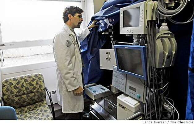 California Pacific Medical Center Doctor Todd Frederick uncovers a device named Elad. Frederick leads a team through phase two of a clinical trial, testing the machine that keeps patients with acute liver failure alive, for short periods of time while they wait for a transplant. Tuesday June 30, 2009. Photo: Lance Iversen, The Chronicle