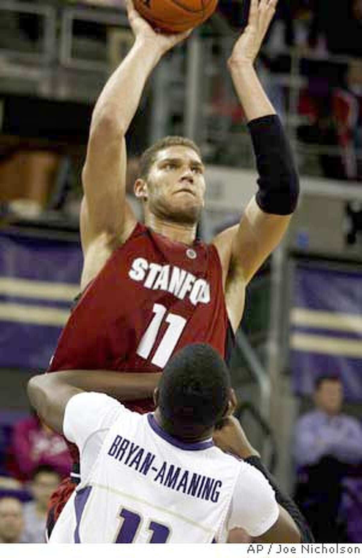 Stanford forward Brook Lopez (11) shoots over Washington forward Matthew Bryan-Amaning (11) in the second half of a college basketball game, Thursday, Jan. 31, 2008 in Seattle. (AP Photo/Joe Nicholson) EFE OUT