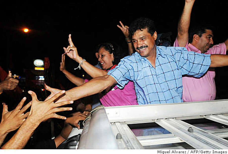 (FILE) Former boxing world champion and mayoral candidate for Nicaragua's ruling Sandinista National Liberation Front, Alexis Arguello (C), is greeted by supporters in Managua on November 9, 2008. Mayor Arguello committed suicide on early July 1, 2009 at his house in Managua. According to doctors his was going through a major depression.  AFP PHOTO/Miguel ALVAREZ (Photo credit should read MIGUEL ALVAREZ/AFP/Getty Images) Photo: Miguel Alvarez, AFP/Getty Images