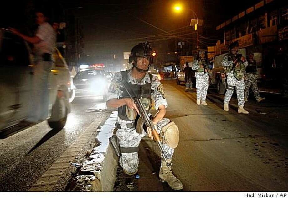 Iraqi National Police patrol in central Baghdad, Iraq, Tuesday, June 30, 2009. U.S. troops pulled out of Iraqi cities on Tuesday in the first step toward winding down the American war effort by the end of 2011. Photo: Hadi Mizban, AP