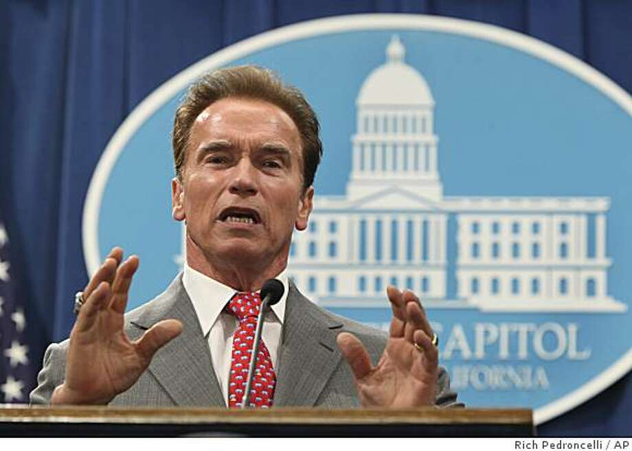 Citing the Legislatures failure to pass a budget plan, Gov. Arnold Schwarzenegger announced that he was declaring a fiscal emergency to address California's deficit during a Capitol news conference in Sacramento, Calif., Wednesday, July 1, 2009.  Lawmakers will have 45 days to send him a plan to balance the state's budget which ended the fiscal year with a $24.3 billion deficit.(AP Photo/Rich Pedroncelli) Photo: Rich Pedroncelli, AP