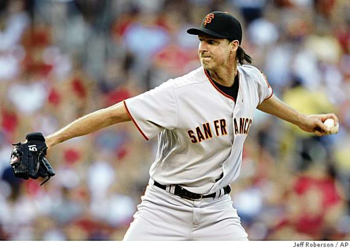 San Francisco Giants starting pitcher Randy Johnson throws during the second inning of a baseball game against the St Louis Cardinals on Tuesday, June 30, 2009, in St. Louis. (AP Photo/Jeff Roberson)