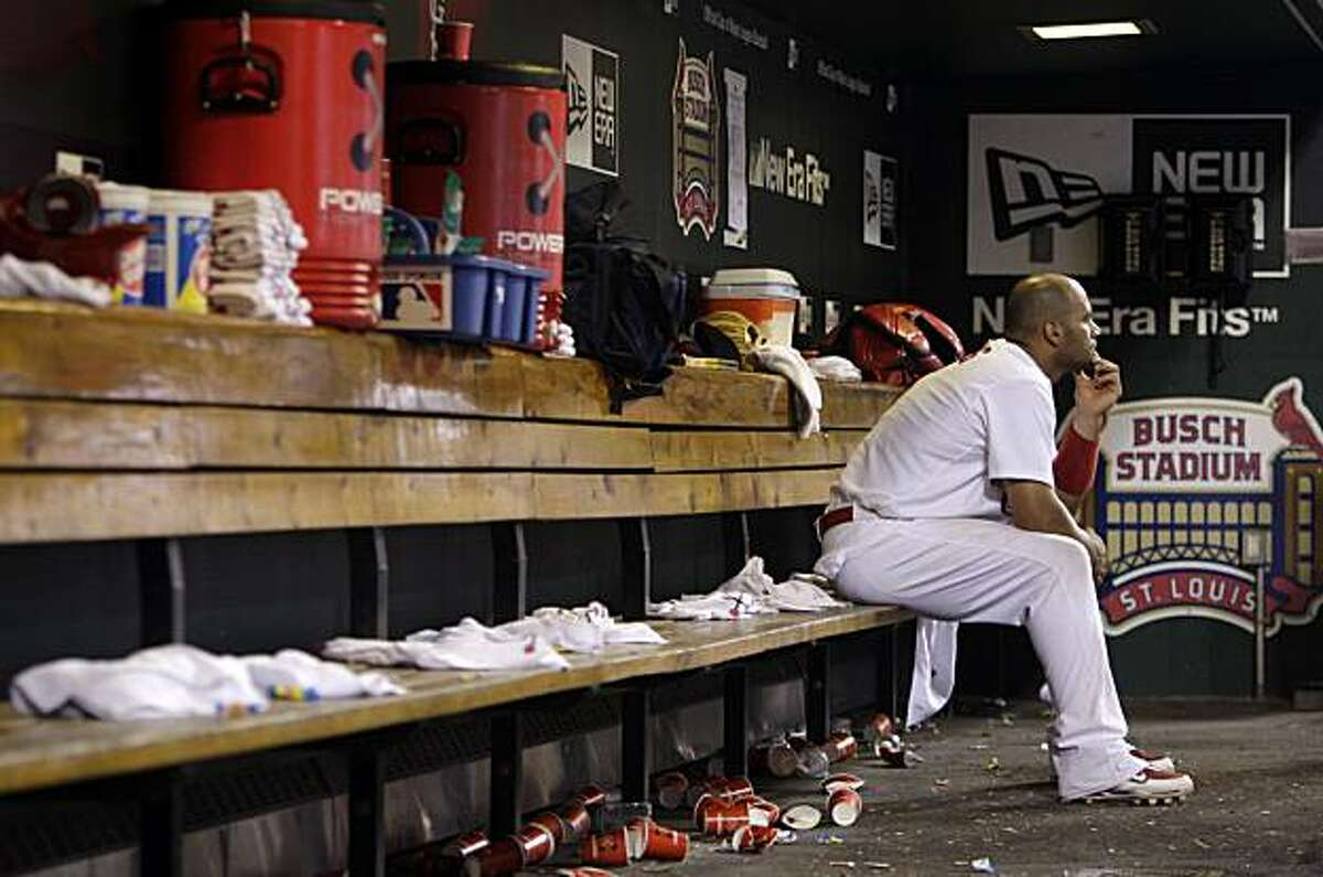 St. Louis Cardinals first baseman Albert Pujols sits in the dugout during the ninth inning of a baseball game against the San Francisco Giants on Tuesday, June 30, 2009, in St. Louis. Pujols hit two home runs in the game, but the Giants won 6-3. (AP Photo/Jeff Roberson)