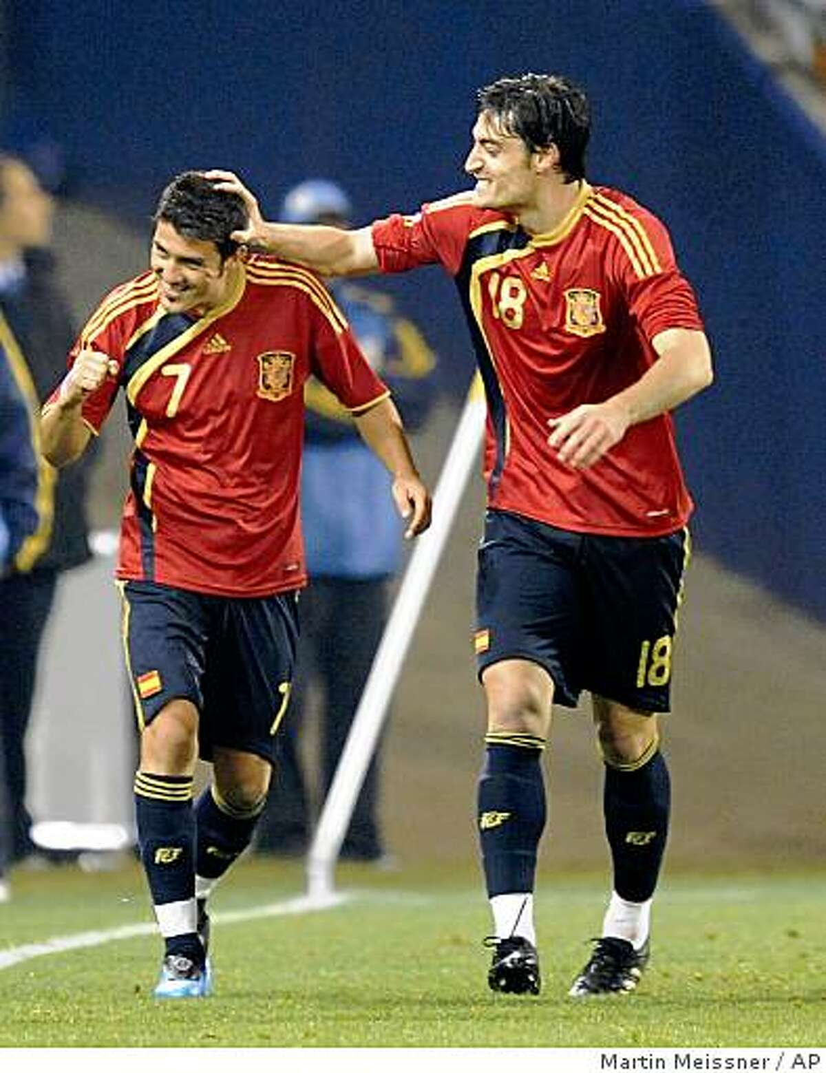 Spain's David Villa, left, reacts after scoring a goal with fellow team member Spain's Albert Riera during their Confederations Cup Group A soccer match against Spain at Free State Stadium in Bloemfontein, South Africa, Saturday, June 20, 2009. (AP Photo/Martin Meissner)