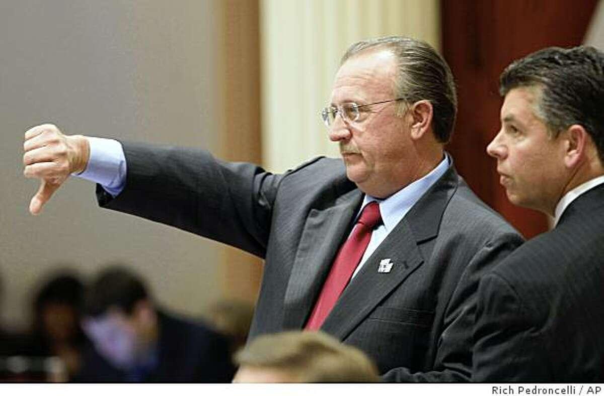 State Sen. Bob Dutton, R-Rancho Cucamonga, left, gives a thumbs down as he votes against a Democratic budget proposal, as Sen. Abel Maldonado, R-Santa Maria, looks on at the Capitol in Sacramento, Calif., Monday, June 29, 2009. (AP Photo/Rich Pedroncelli)