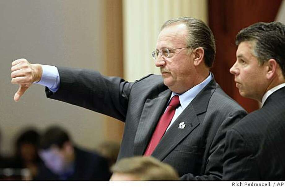State Sen. Bob Dutton, R-Rancho Cucamonga, left, gives a thumbs down as he votes against a Democratic budget proposal, as Sen. Abel Maldonado, R-Santa Maria, looks on at the Capitol in Sacramento, Calif., Monday, June 29, 2009. (AP Photo/Rich Pedroncelli) Photo: Rich Pedroncelli, AP