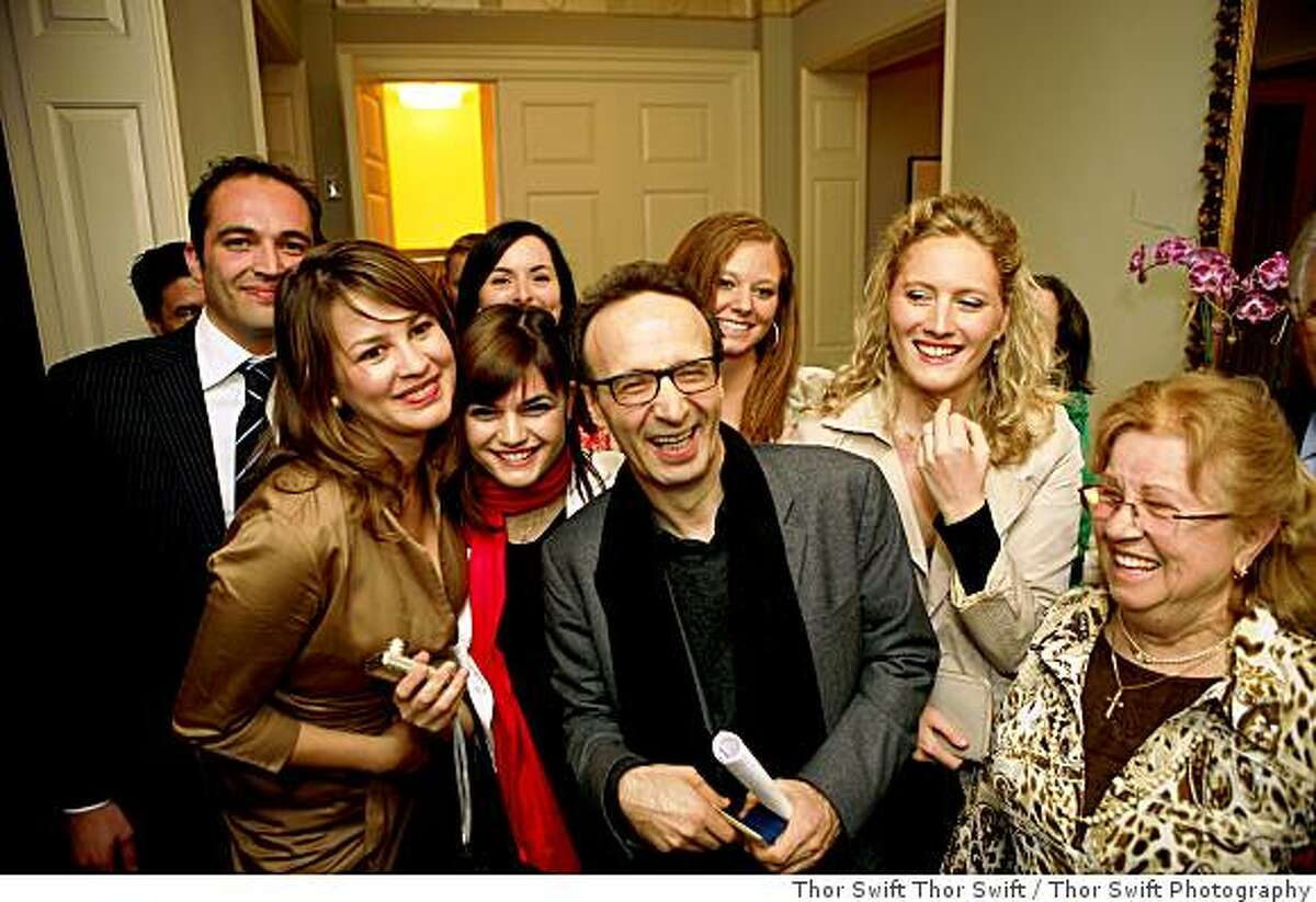 Academy award winning actor Roberto Benigni is surrounded by admirers, including (far left) Paolo Perazzo of Cisco Systems and (far right, wearing glasses) Paola Silvestri. Various photographs from the National Italian American Foundation awards dinner and reception, Tuesday May, 26 and Wednesday May 27, 2009 at the Fairmont Hotel in San Francisco, Calif. Thor Swift for NIAF