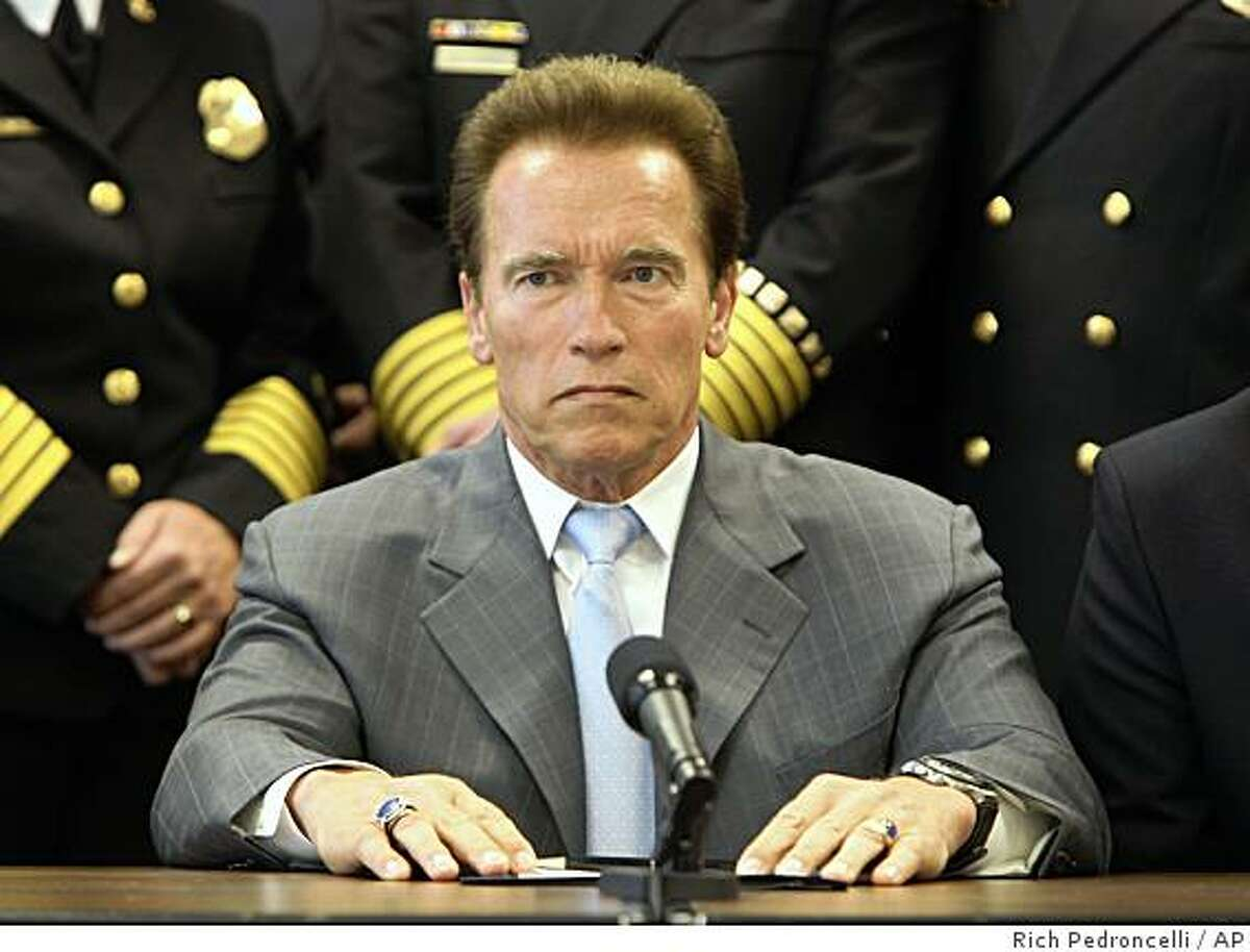 Gov. Arnold Schwarzenegger listens to a reporter's question concerning the state's pending cash crisis, following a meeting with the Governor's Blue Ribbon Fire Commission, at the Capitol in Sacramento, Calif., Monday, June 29, 2009. Schwarzenegger said he would veto any budget plan that includes tax increases and urged lawmakers to reach a solution to the states $24.3 billion state budget plan deficit. (AP Photo/Rich Pedroncelli)