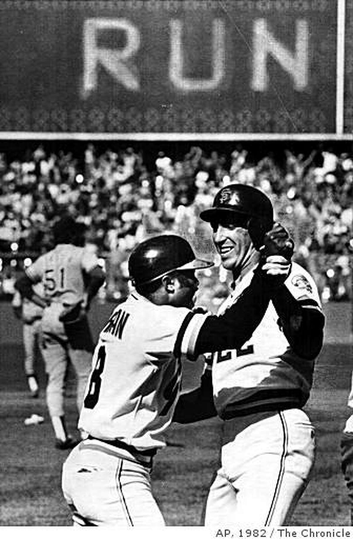 Giants' Joe Morgan (left) celebrates with Jack Clark after hitting a three-run homer that helped eliminate L.A. in 1982.