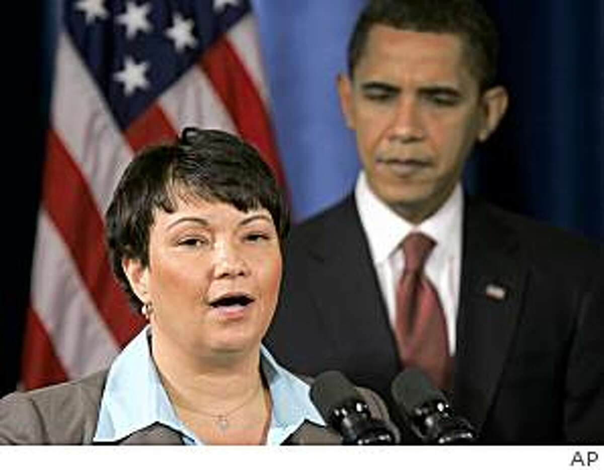** FILE ** In this Dec. 15, 2008 file photo, President-elect Barack Obama, right, listens EPA administrator-designate Lisa Jackson addresses the media at a news conference in Chicago. (AP Photo, File)