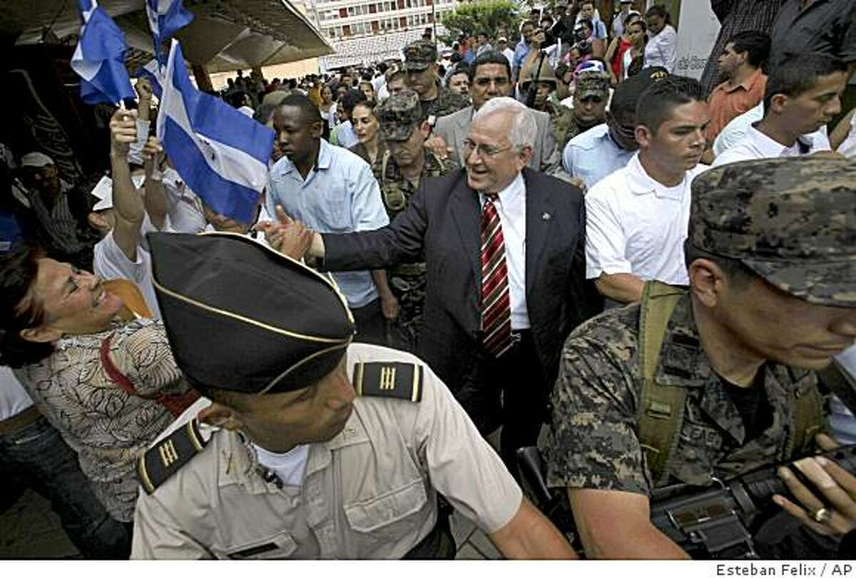 Honduras' congressional leader Roberto Micheletti, whom Congress appointed president on Sunday, leaves escorted by soldiers a rally against ousted President Manuel Zelaya at the central park in Tegucigalpa, Tuesday June 30, 2009. The U.N. General Assembly demanded the immediate restoration of ousted president Zelaya but Micheletti said Zelaya could be arrested if he returns home.(AP Photo/Esteban Felix)