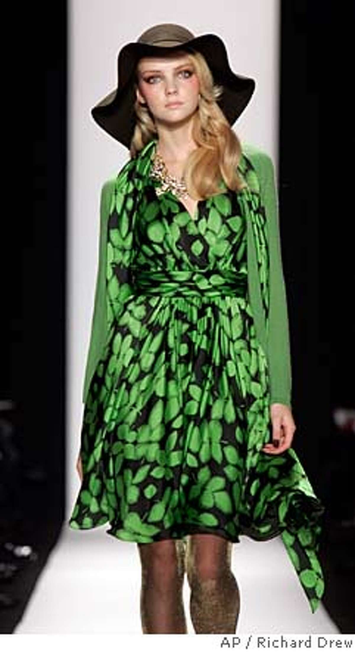 The fall 2008 collection of Badgley Mischka is modeled during Fashion Week in New York Tuesday, Feb 5, 2008. (AP Photo/Richard Drew)