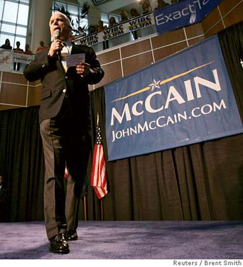 US Republican presidential candidate Senator John McCain (R-AZ) makes a speech on stage at a town hall meeting in Indianapolis, Indiana February 22, 2008. REUTERS/Brent Smith (UNITED STATES) US PRESIDENTIAL ELECTION CAMPAIGN 2008 0 Photo: BRENT SMITH