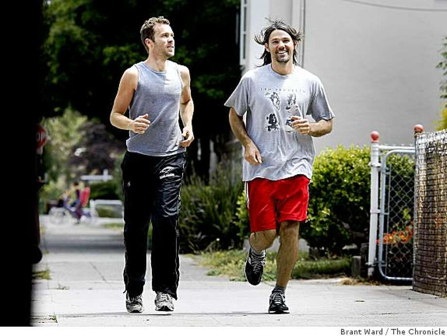 Brian (left) and Matt train for their upcoming run to Portland on the streets of Oakland. Matt Szymankowski and Brian Rutherford are running from Oakland to Portland, 831 miles, to raise money for several causes. Photo: Brant Ward, The Chronicle