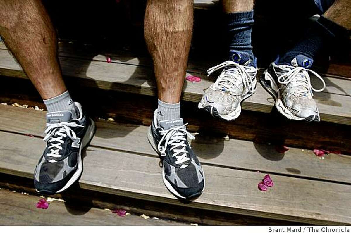 Matt (left) and Brian's running shoes which they hope to replace before the big run. Matt Szymankowski and Brian Rutherford are running from Oakland to Portland, 831 miles, to raise money for several causes.