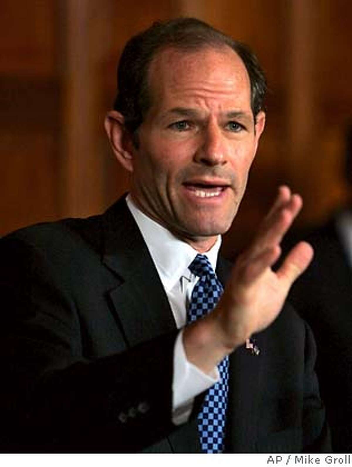 **FILE** New York Gov. Eliot Spitzer answers questions during a news conference at the Capitol in Albany, N.Y., in this Thursday, July 26, 2007 file photo. A prominent political consultant for the state Senate Republicans agreed to resign Wednesday after reports surfaced that he had made a threatening phone call to Gov. Eliot Spitzer's father. Roger Stone, who in the 1970s worked on President Nixon's re-election effort and has also done work for Presidents Bush and Reagan, denied making the call and said he was