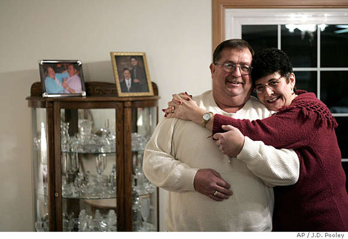 **ADVANCE FOR SUNDAY, FEB. 10** George Brzeczek and wife Carolyn are seen in their home, Friday, Jan. 18, 2008, in Helena, Ohio. George and Carolyn met through the online matchmaking service, FarmersOnly and were married last November. (AP Photo/J.D. Pooley)