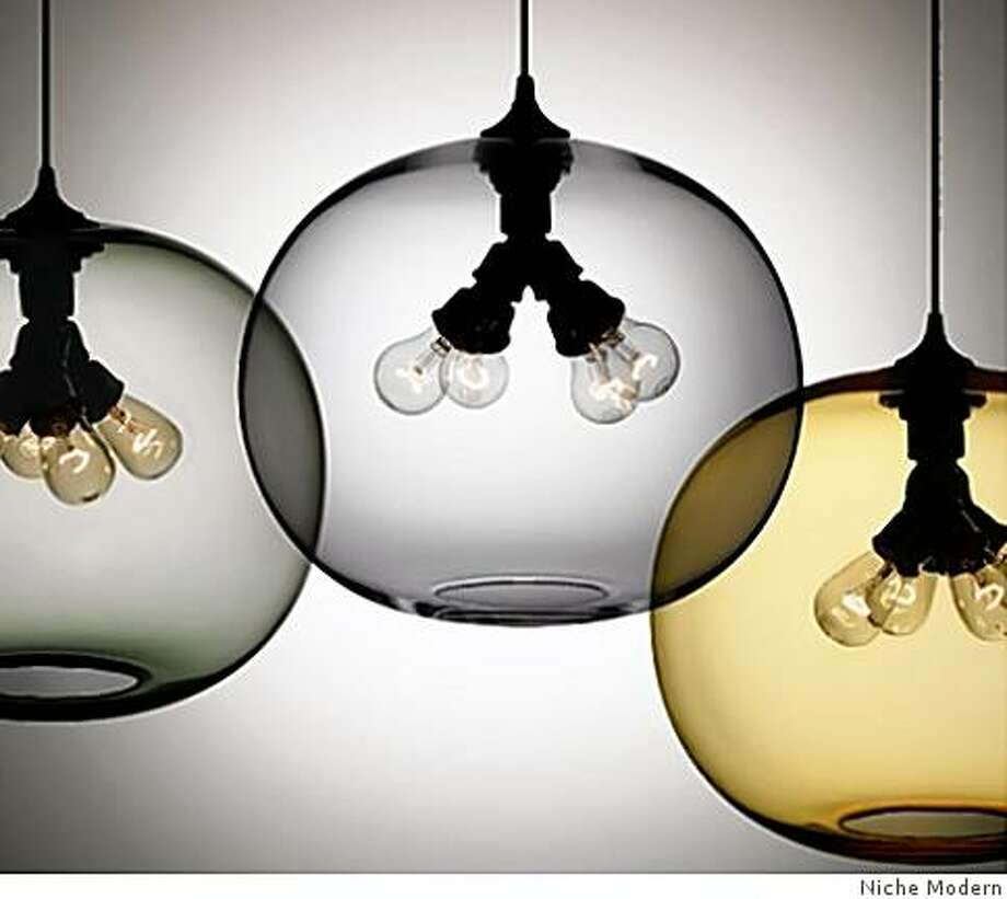 "Remodelista.com has a section of the website called ""Steal this look"" to provide inspiration for your own home design. Pictured is a trio of handblown glass Terra pendants, designed by Jeremy Pyles for Niche Modern, in three different shades: Smoke, Amber and Gray. Photo: Niche Modern"