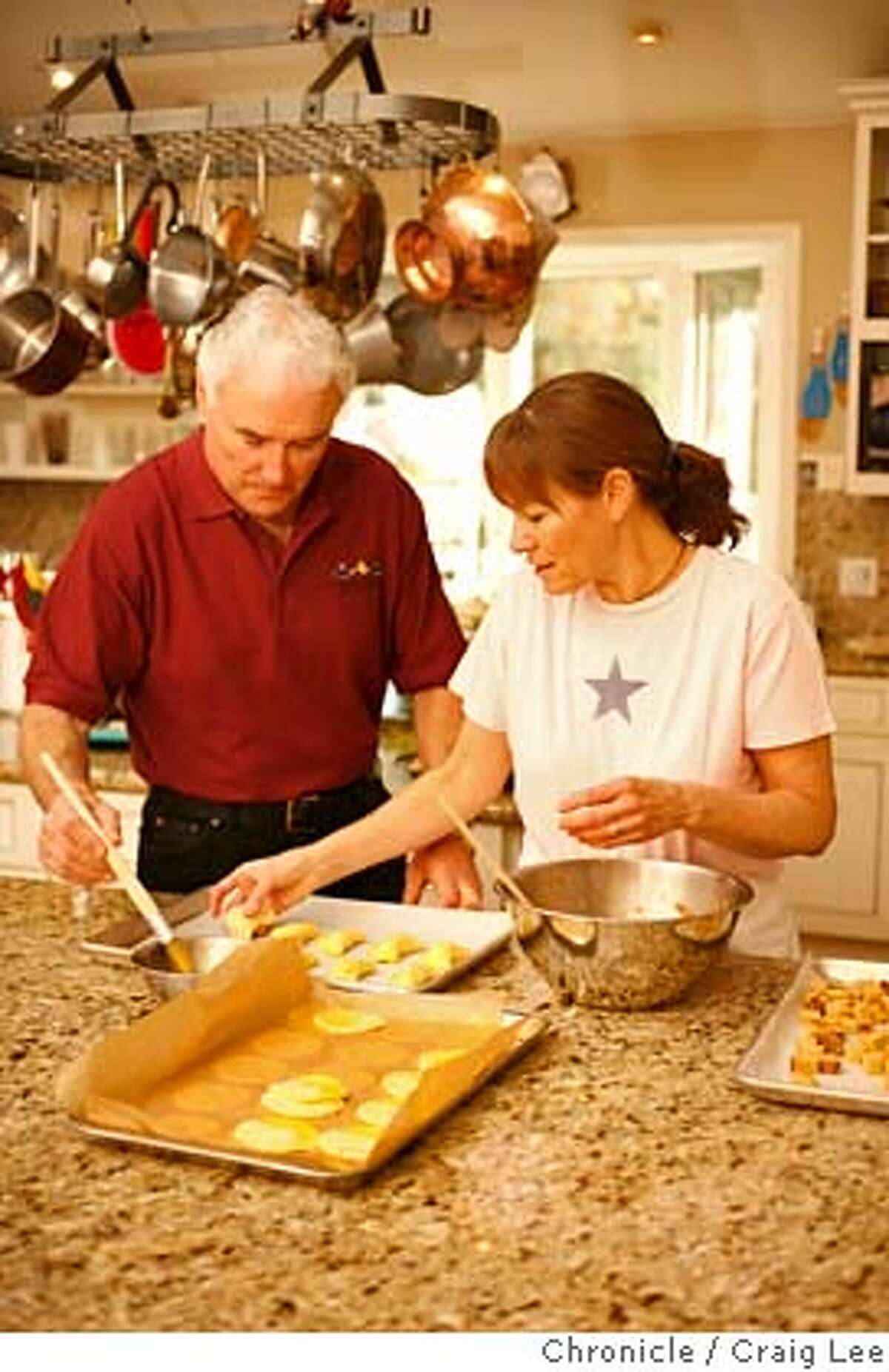 Photo of Barry Taylor and his wife, Elaine, working in their home kitchen preparing a charity dinner party they are throwing. They are making empanadas. Valentine's Day story on couples who are food incompatible. Elaine Taylor suffers from celiac disease, meaning she has to eat only gluten-free foods. Being diagnosed turned her and her husband, Barry's world upside down. Her husband has to keep food separate from hers and not cause cross contamination or it could make Elaine very sick. photo by Craig Lee / The Chronicle MANDATORY CREDIT FOR PHOTOG AND SF CHRONICLE/NO SALES-MAGS OUT