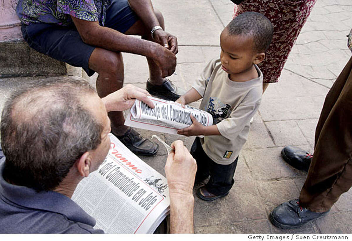 HAVANA - FEBRUARY 19: Cubans buy the official communist party newspaper Granma, which published a resignation by President Fidel Castro as President and Commander-in-Chief, February 19, 2008 in Havana, Cuba. A new President will be elected during the National Assembly meeting on February 24. Castro has not been seen in public since he fell ill on July 26, 2006. His brother, Raul Castro, has been acting as President ever since. (Photo by Sven Creutzmann/Mambo photo/Getty Images)