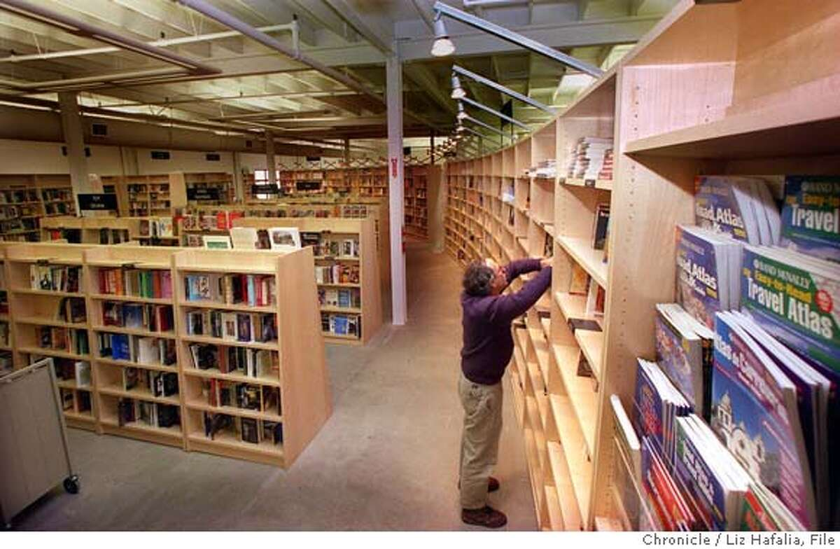 Andy Ross, owner of Cody's, shelving books in the new book store on Fourth St. in Berkeley in 1997. That store will close and a new site will open in downtown Berkeley