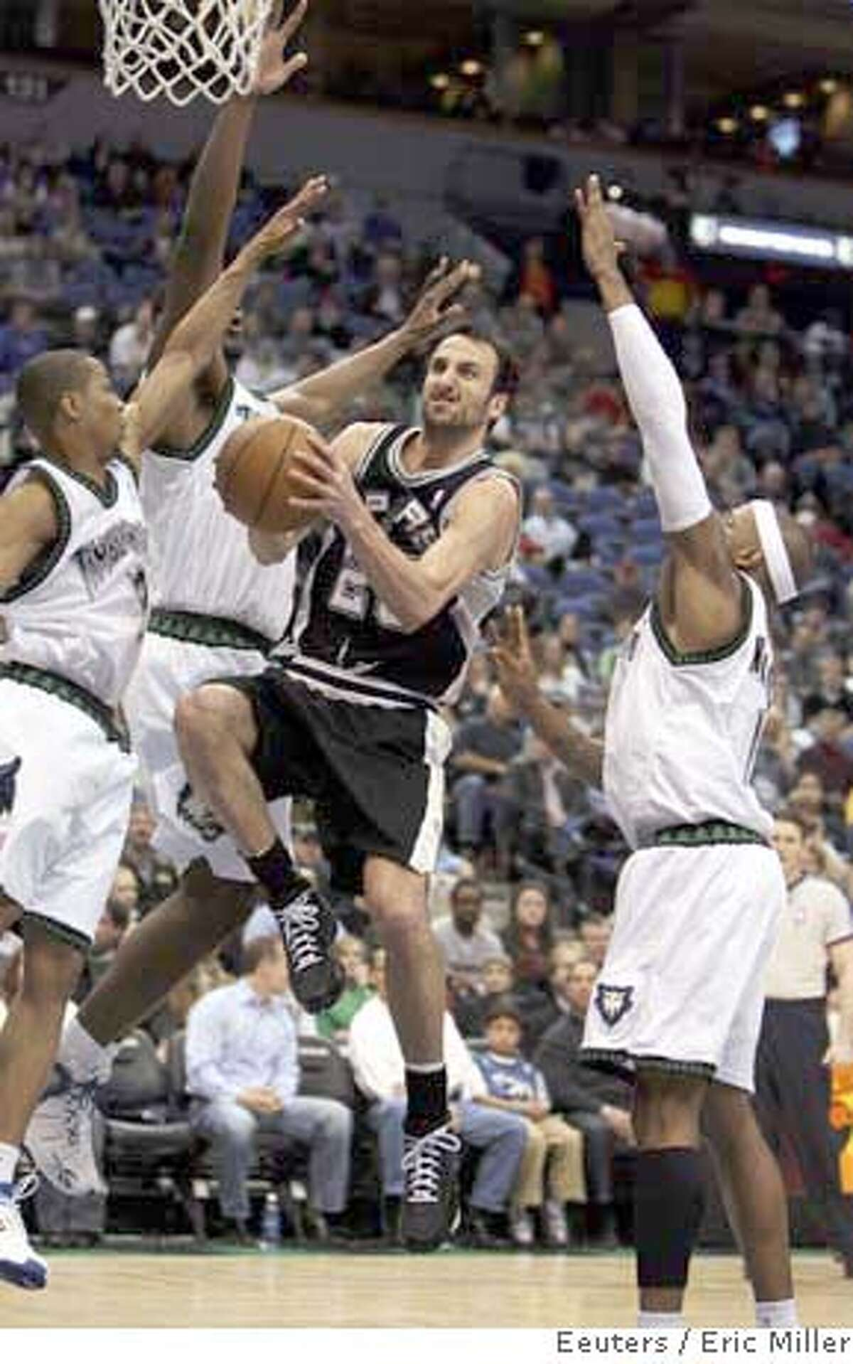 San Antonio Spurs guard Manu Ginobili (C) attempts a layup around Minnesota Timberwolves guard Sebastian Telfair (L), forward Al Jefferson and guard Rashad McCants (R) during the first half of their NBA basketball game in the Target Center in Minneapolis, February 21, 2008. REUTERS/Eric Miller (UNITED STATES)