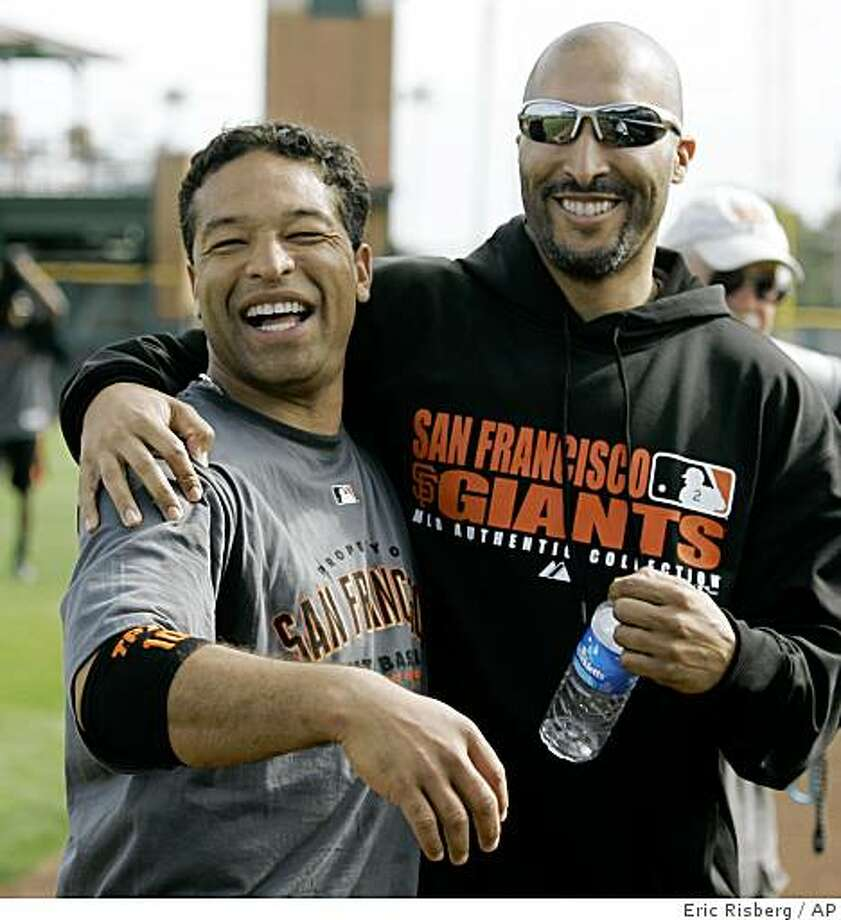 San Francisco Giants left fielder Dave Roberts, left, and right fielder Randy Winn, right, embrace each other during their spring training baseball workout in Scottsdale, Ariz., Tuesday, Feb. 19, 2008. (AP Photo/Eric Risberg) Photo: Eric Risberg, AP
