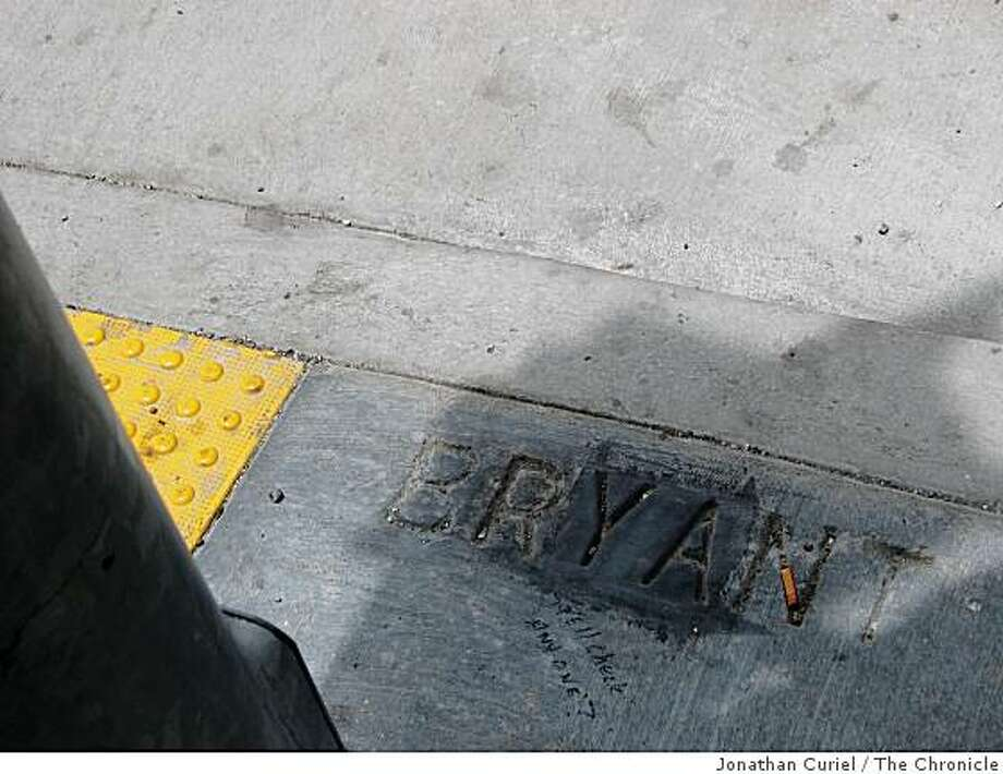 fixes bryant sign at 7th street Photo: Jonathan Curiel, The Chronicle
