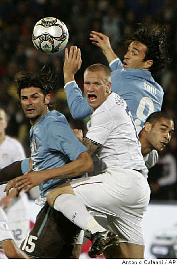 USA's Jay DeMerit, center, vies for the ball with Italy's Vincenzo Iaquinta, left, Italy's Luca Toni, top right, and teammate Oguchi Onyewe, during their Confederations Cup Group B soccer match at Loftus Versfeld Stadium in Pretoria, South Africa, Monday, June 15, 2009.  Italy won 3-1. (AP Photo/Antonio Calanni) Photo: Antonio Calanni, AP