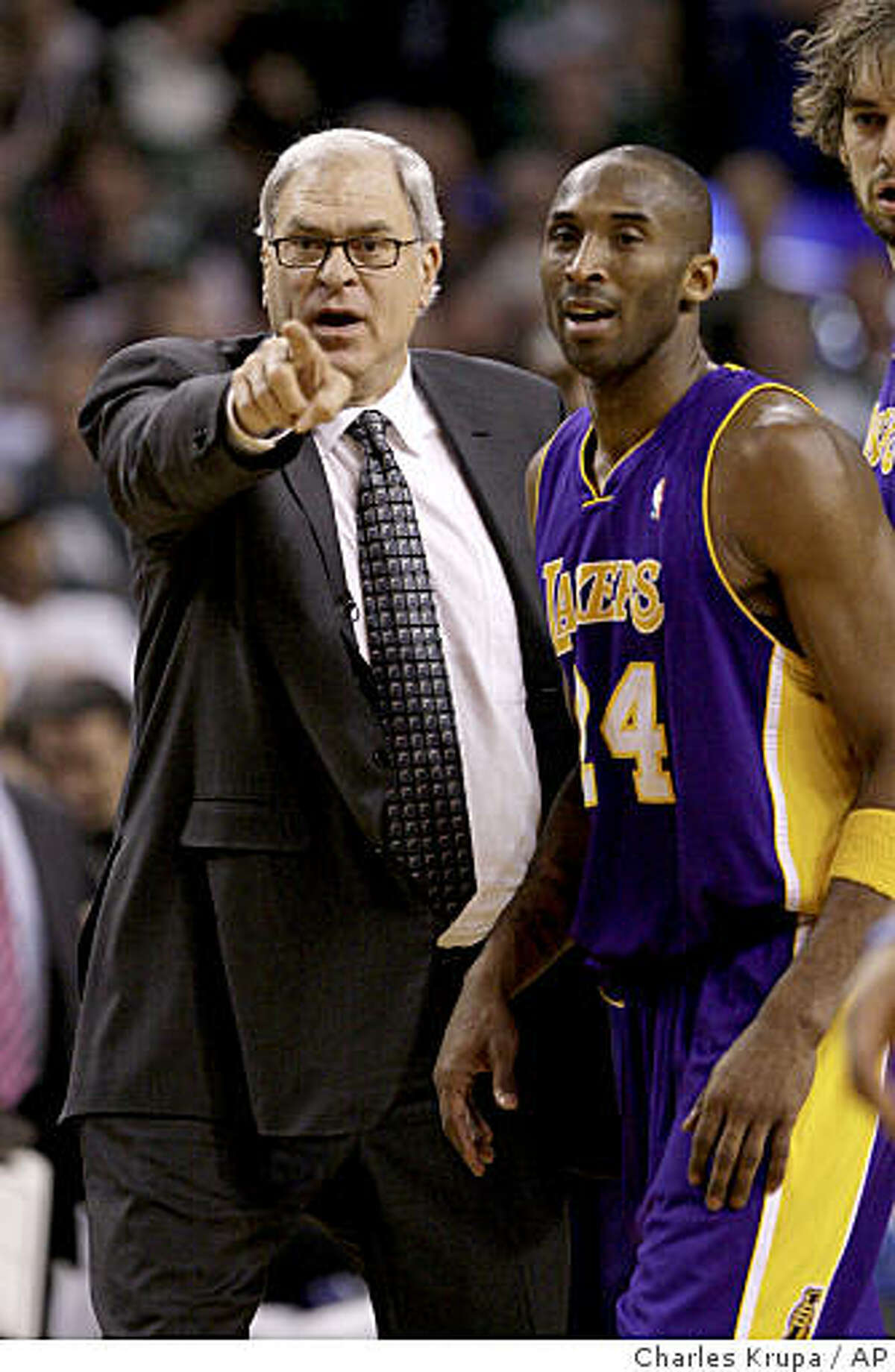 FILE - In this Feb. 5, 2009, file photo, Los Angeles Lakers head coach Phil Jackson, left, and Kobe Bryant talk during their basketball game against the Boston Celtics in Boston. Bryant could become an unrestricted free agent next month. What's more, coach Phil Jackson hasn't said if he's coming back. (AP Photo/Charles Krupa, File)