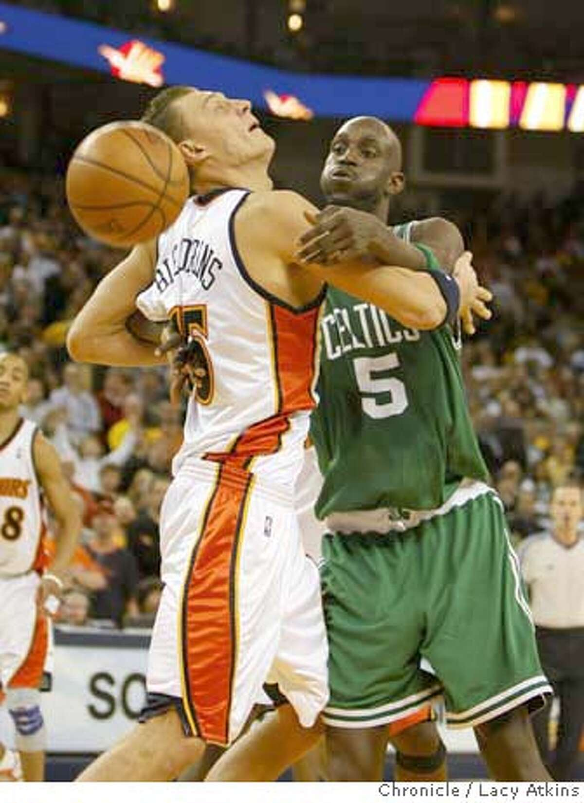 Golden State Warriors Andris Biedrins and Boston Celtics Kevin Garnett fight for the ball at the end of the game, Wednesday Feb. 20, 2008 in Oakland, Ca.( Lacy Atkins / San Francisco Chronicle) MANDATORY CREDIT FOR PHOTOG AND SAN FRANCISCO CHRONICLE/NO SALES MAGS OUT