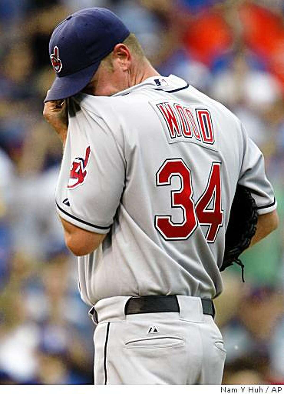 Cleveland Indians relief pitcher Kerry Wood wipes his face during the ninth inning of an interleague baseball game against the Chicago Cubs in Chicago, on Friday, June 19, 2009. The Cubs won 8-7 in 10 innings.(AP Photo/Nam Y. Huh)