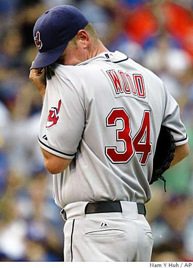 Cleveland Indians relief pitcher Kerry Wood wipes his face during the ninth inning of an interleague baseball game against the Chicago Cubs in Chicago, on Friday, June 19, 2009. The Cubs won 8-7 in 10 innings.(AP Photo/Nam Y. Huh) Photo: Nam Y Huh, AP